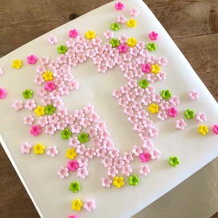 flower cross multi coloured baptism cake for a girl DIY kit from Cake 2 The Rescue